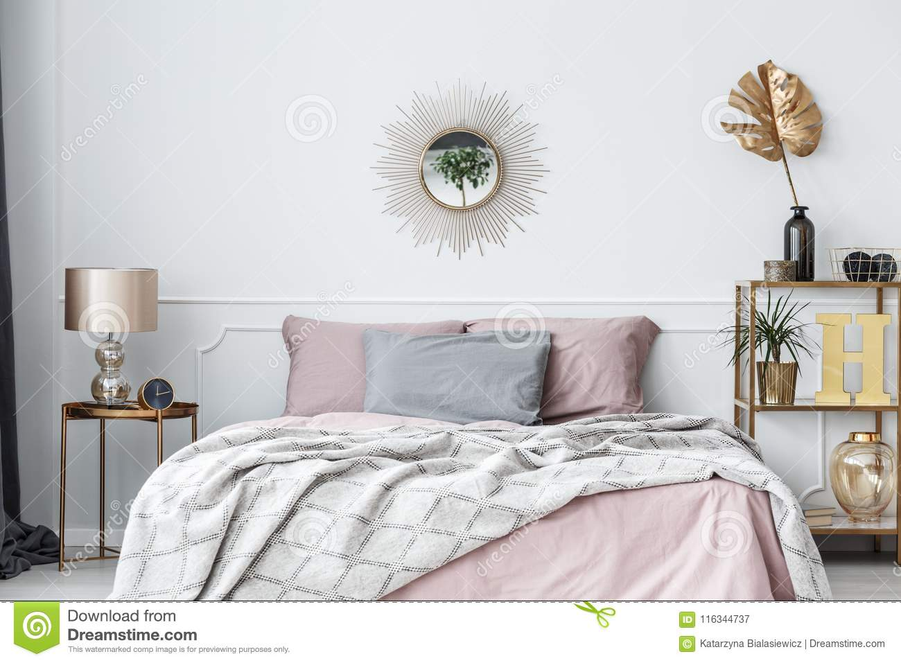 Gentil Elegant, Pink And Gold Bedroom Interior With Sun Shaped Mirror Above Bed  With Pillows And Blanket