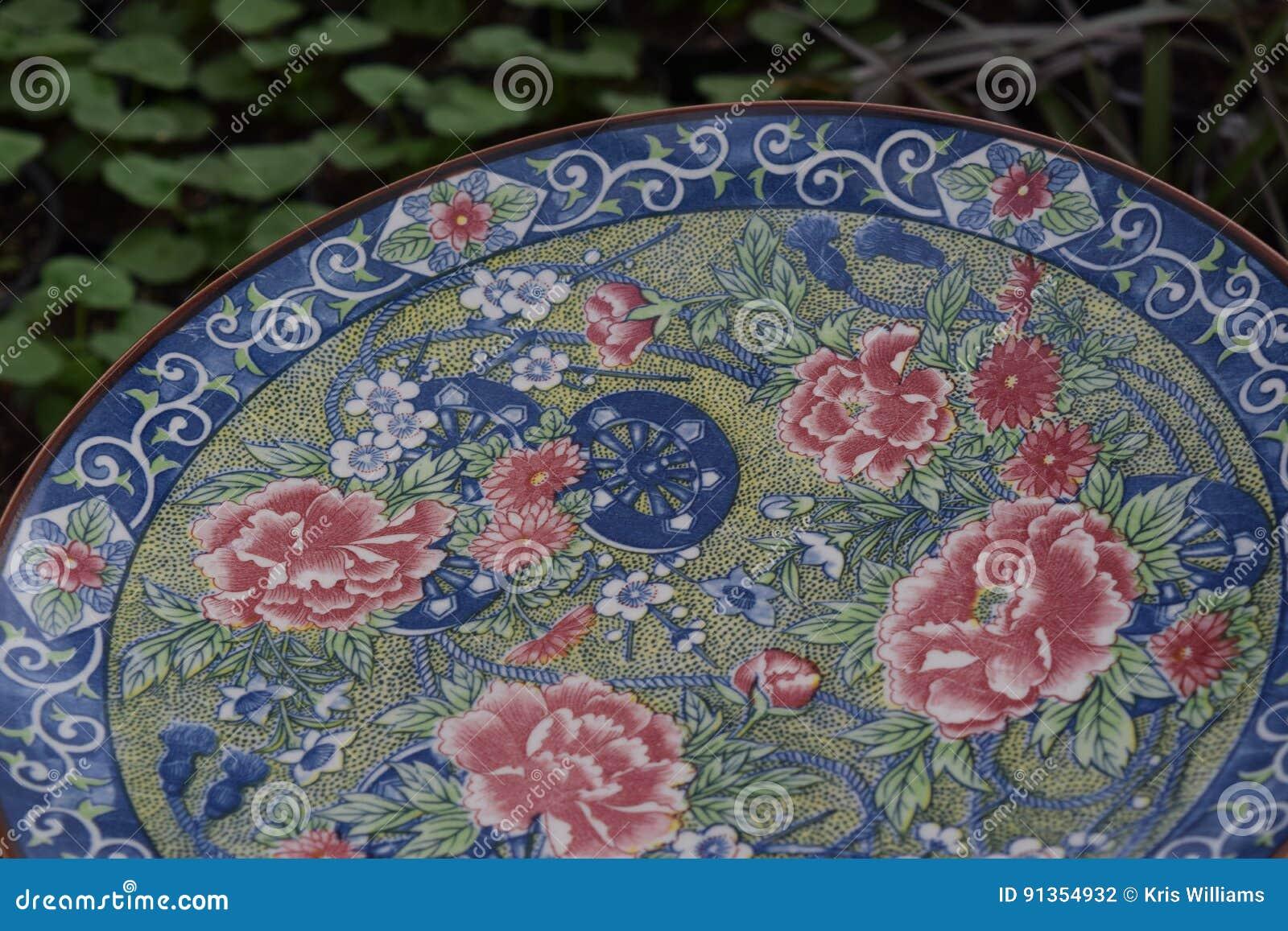 Elegant plate bird bath close-up