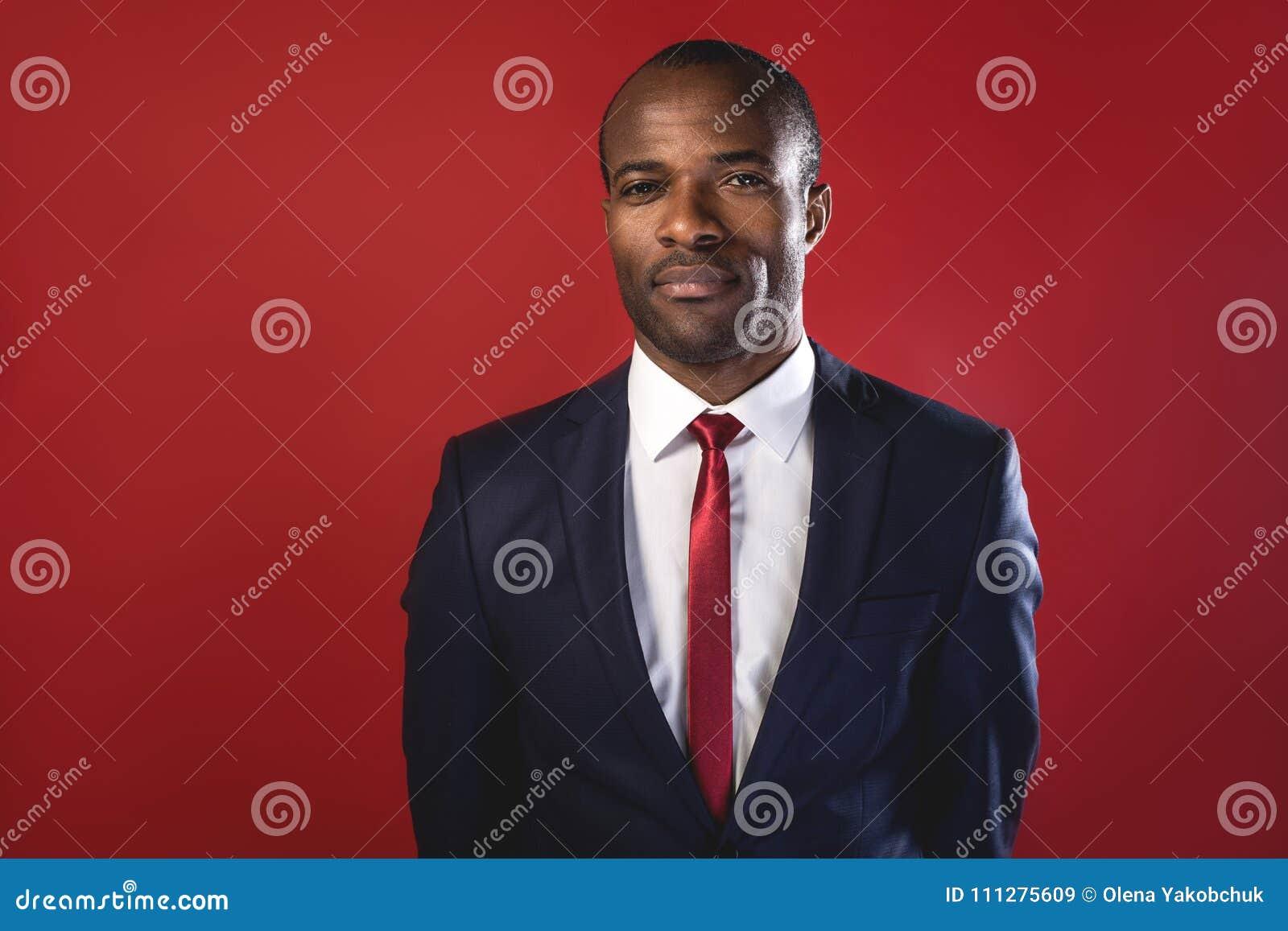 Elegant pleasant businessman is expressing confidence