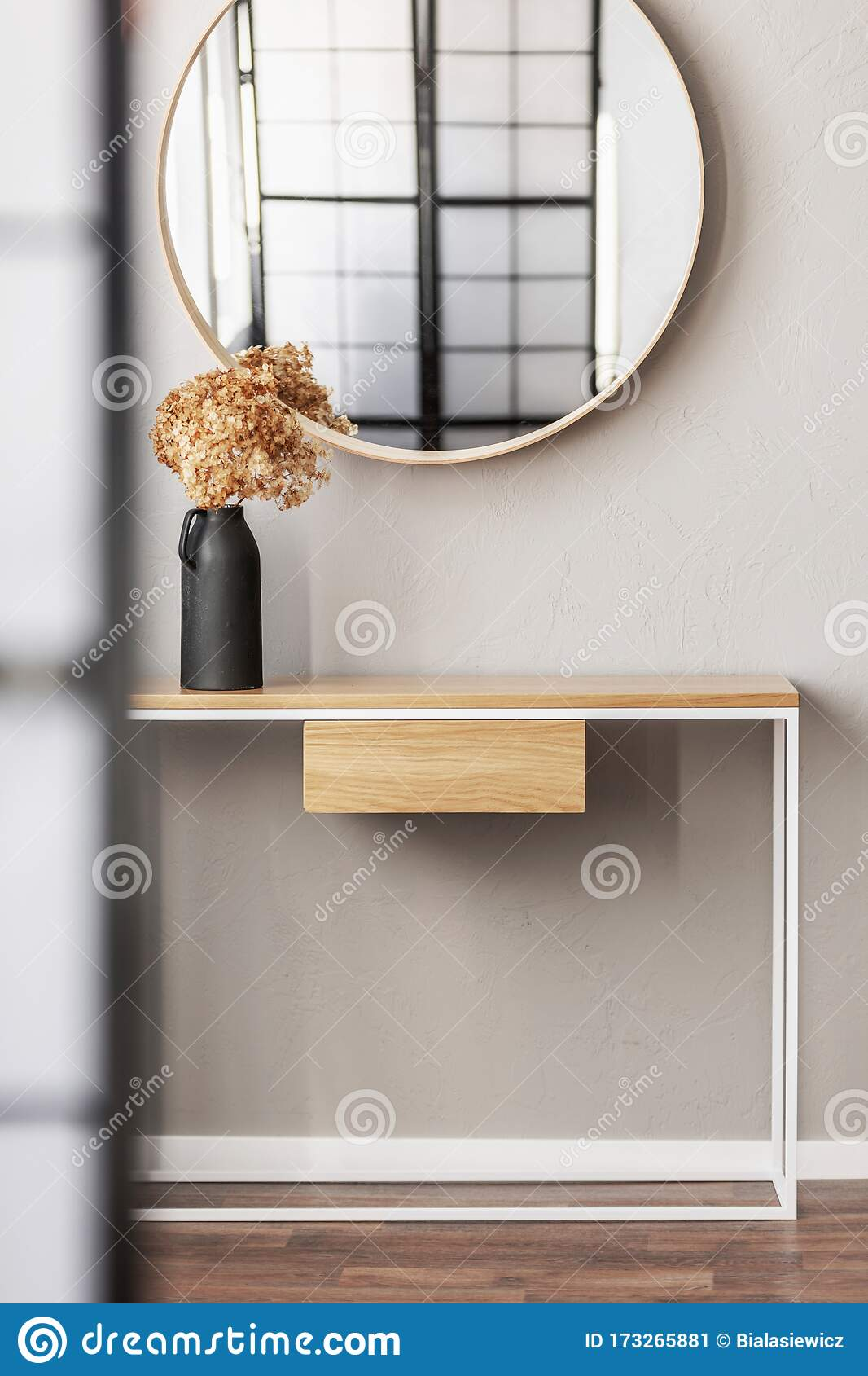 Round Mirror In Wooden Frame Above Fancy Console Table With Flowers In Vase In Trendy Bedroom Interior With Beige Vase Stock Image Image Of Tasteful Bright 173265881