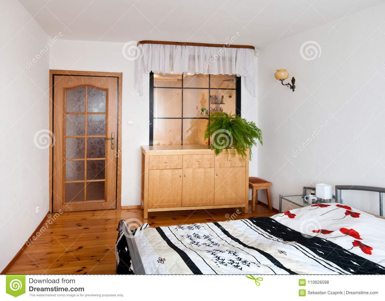 An Elegant Simple Bedroom With Double Bed Wooden Flooring And Timber Cupboard Bright Daylight Home Architecture Design Concept