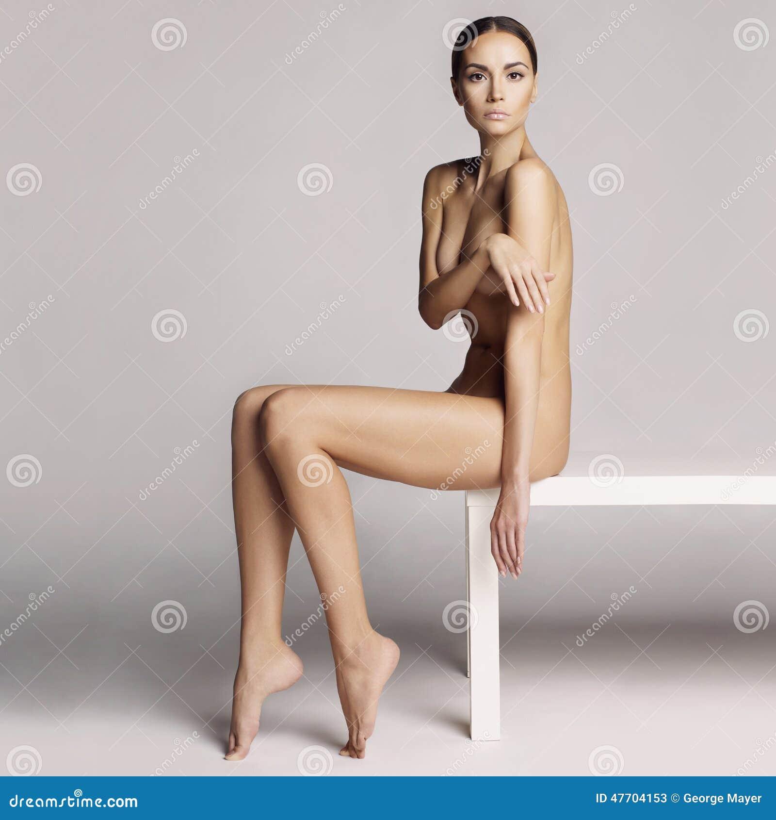 Elegant beautiful sitting lady on white background.