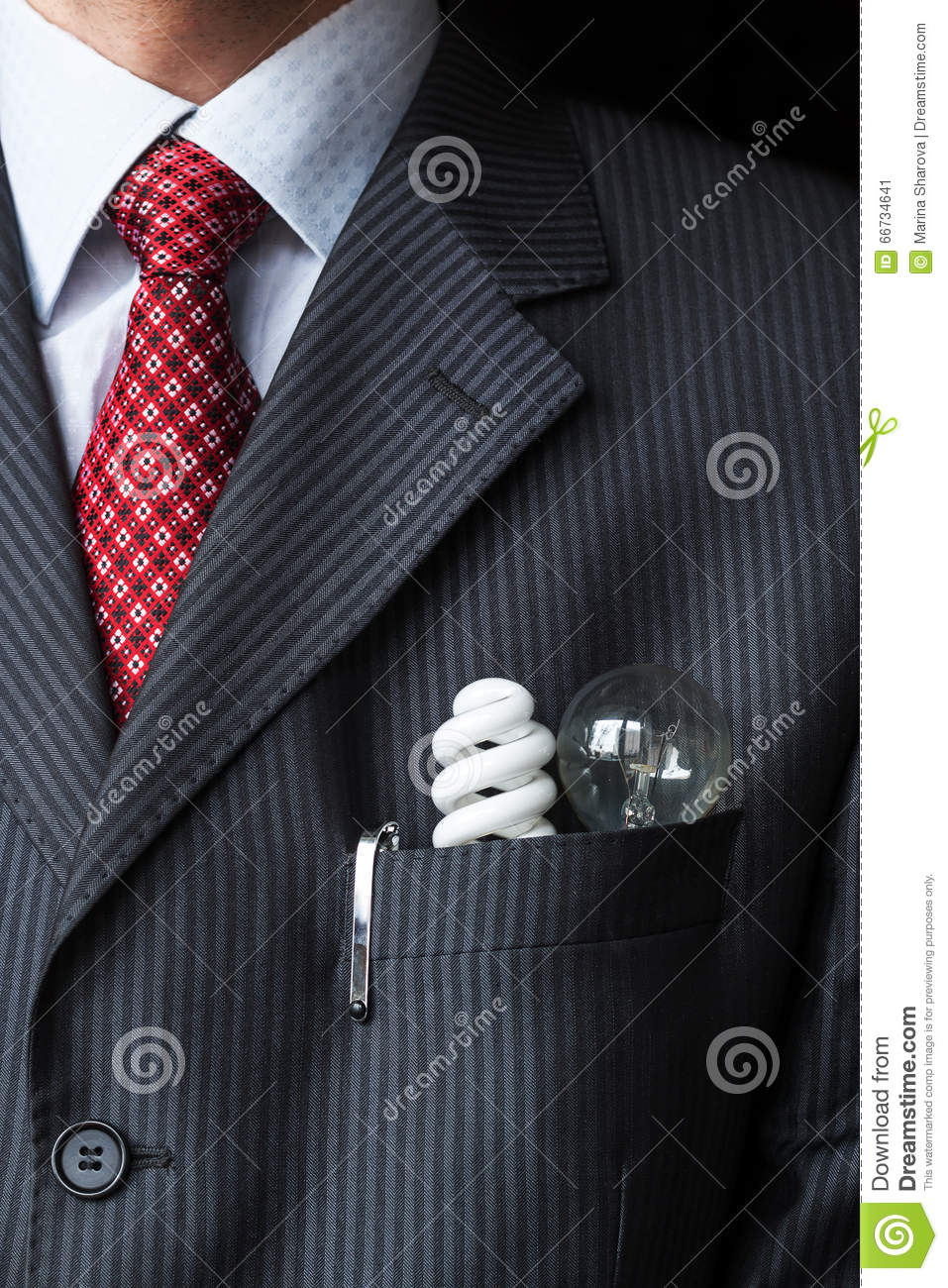 The elegant stylish businessman keeping two light bulbs - Incandescent and fluorescent energy efficiency - in his breast pocket.