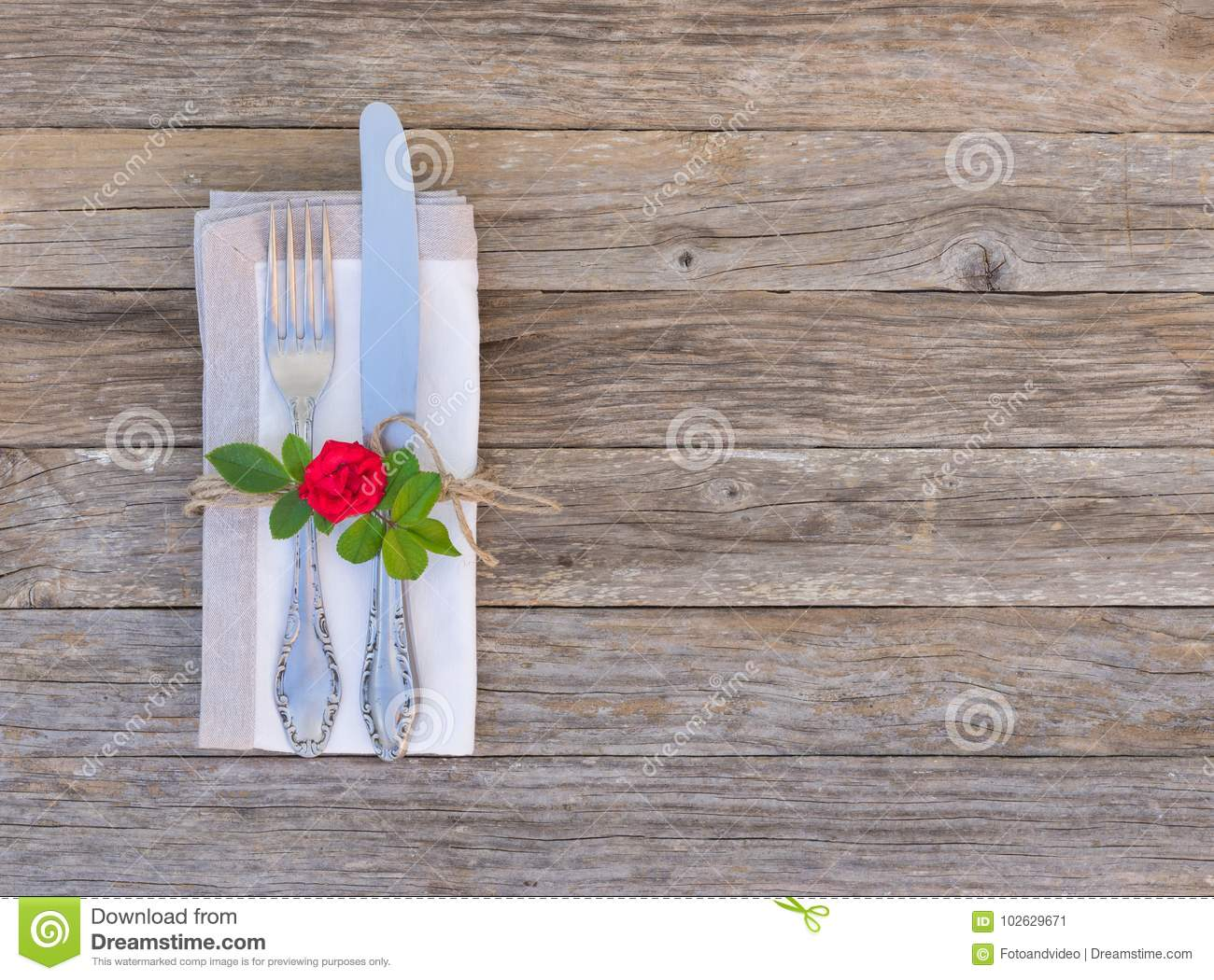 Romantic Dinner Concept Table Setting With Cutlery And Red Rose