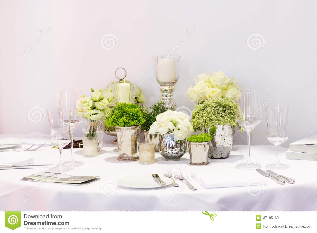 Elegant Table Set In Green And White For Wedding Or Event