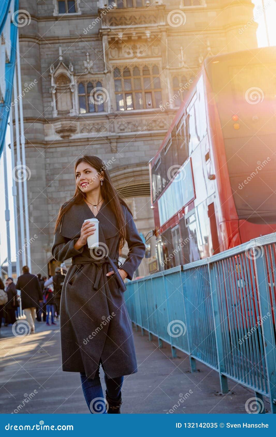 Woman walks down the Tower Bridge in London, United Kingdom