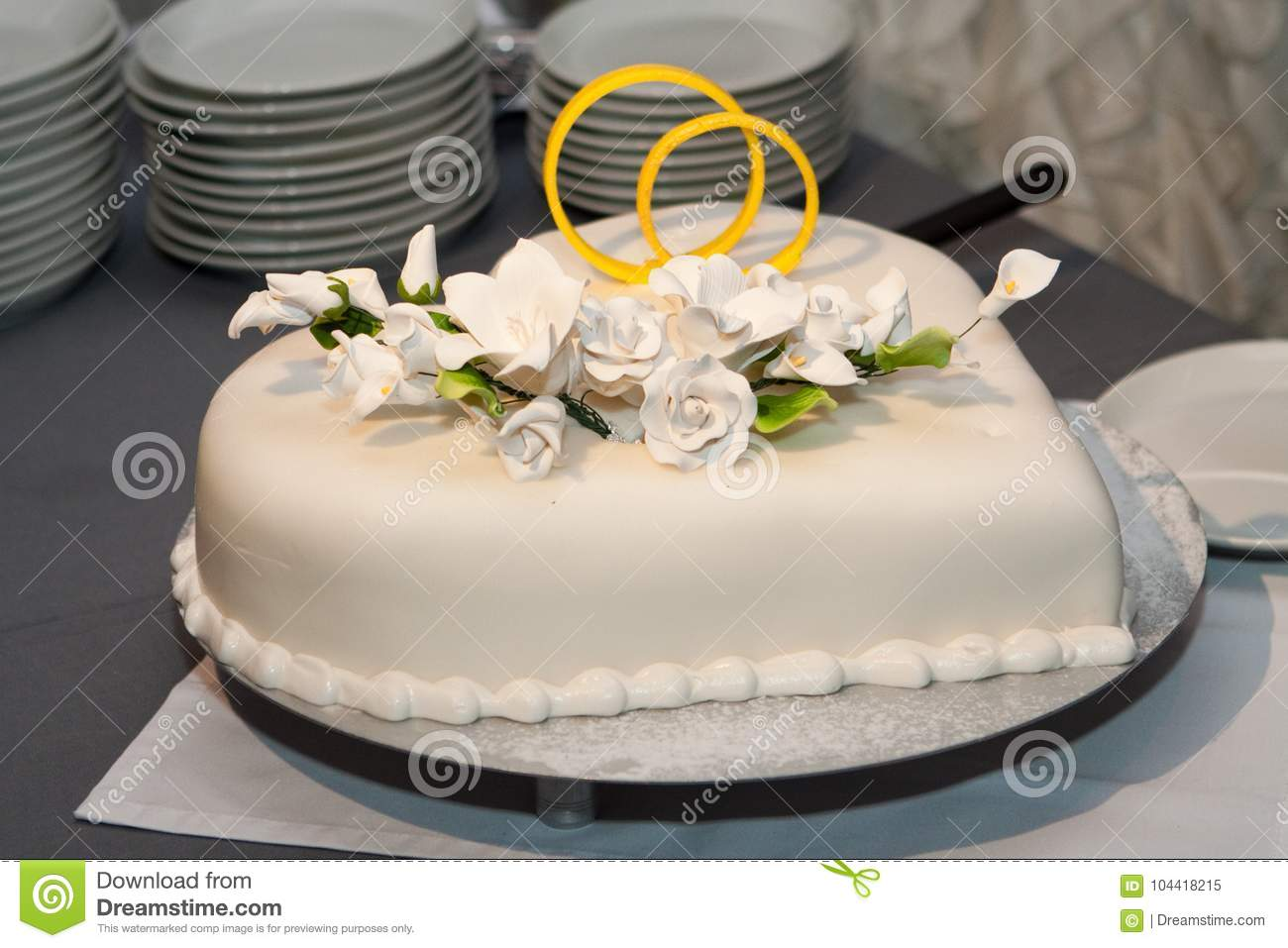 White Wedding Cake Decorated Flowers And Golden Rings Stock Image ...