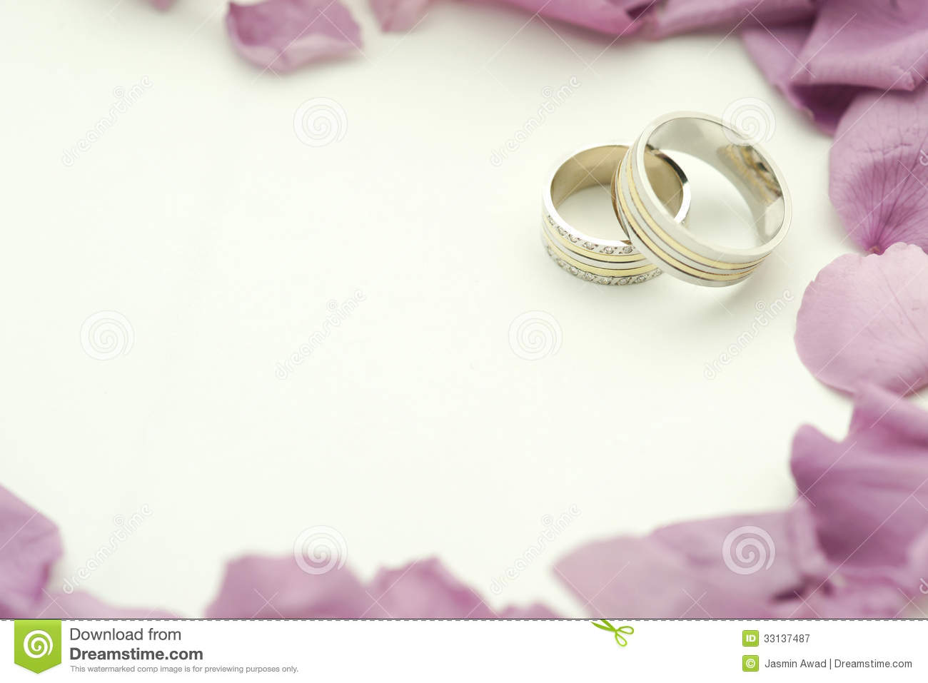Wedding rings with roses and copy space.