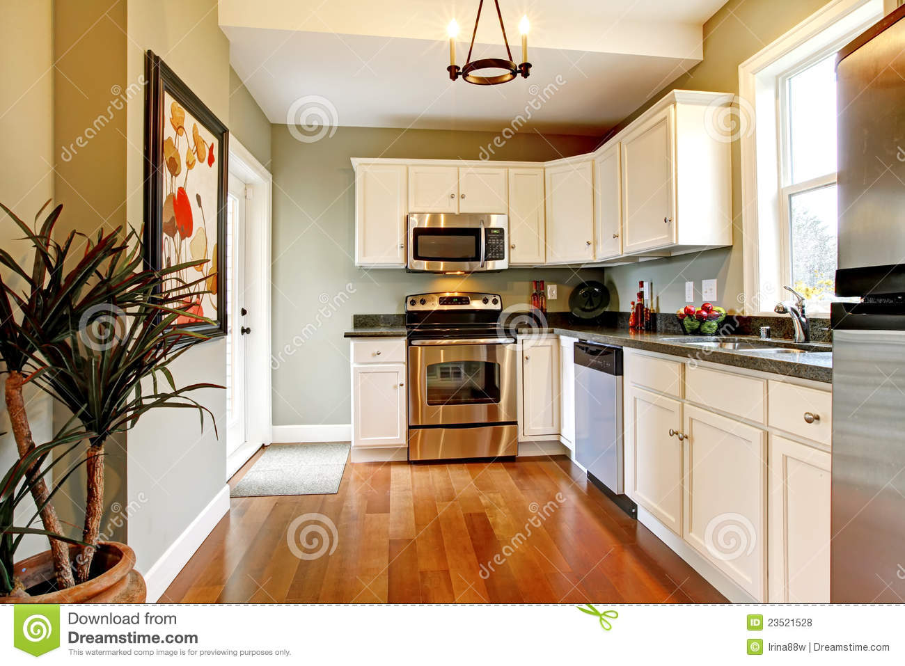 Elegant white and green kitchen with cherry floor stock for Colore pareti cucina bianca