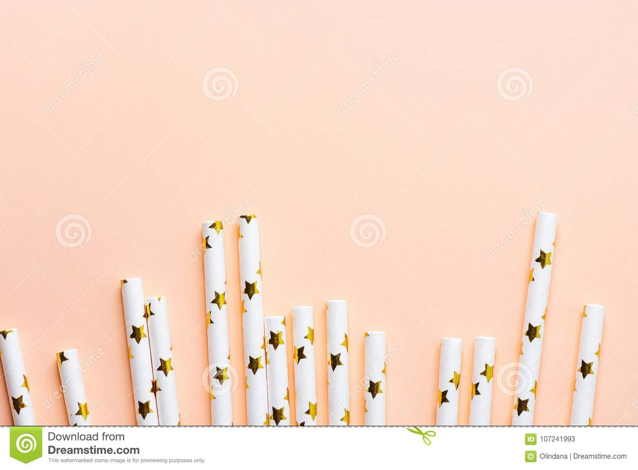 Elegant White Paper Drinking Straws with Golden Stars Pattern Scattered as Border Frame on Pink Peachy Background. Birthday Party