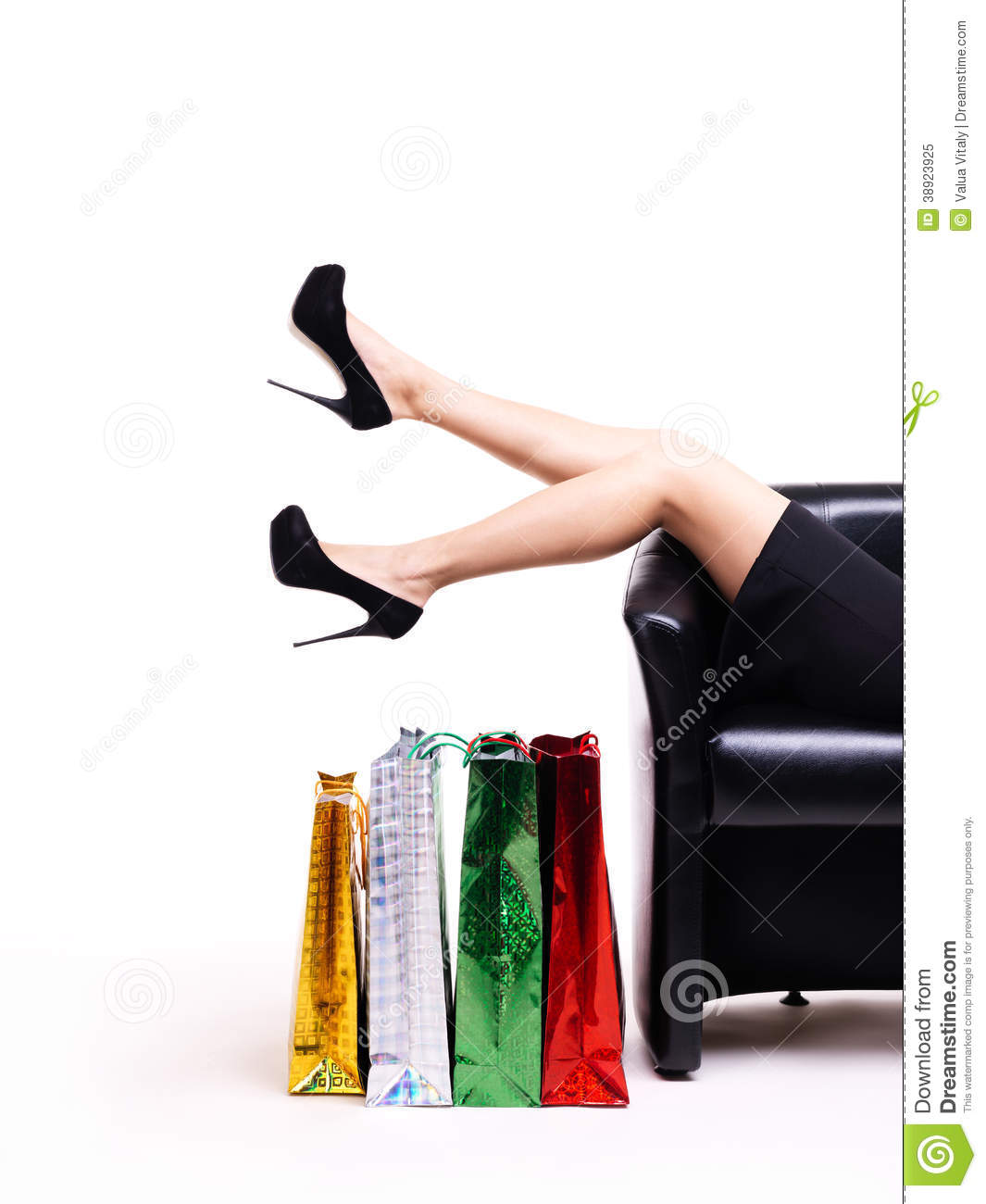 Elegant Woman In Black Dress With Shopping Bags Stock