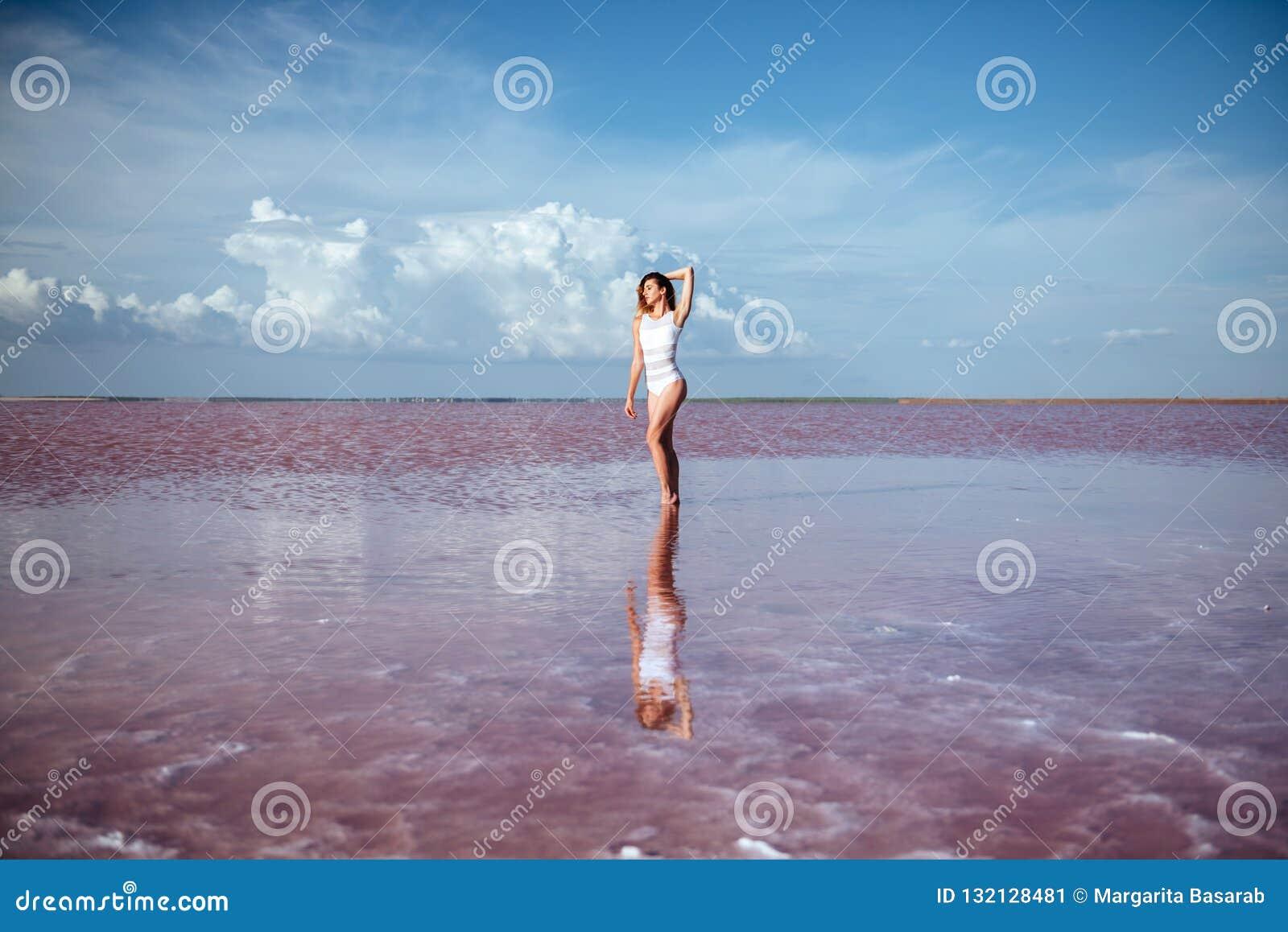 Elegant woman dancing on water.