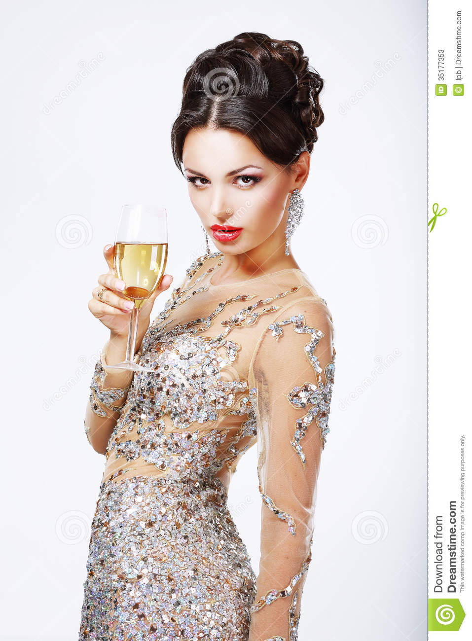 Elegant luxurious beautiful sexy woman with a glass of champagne