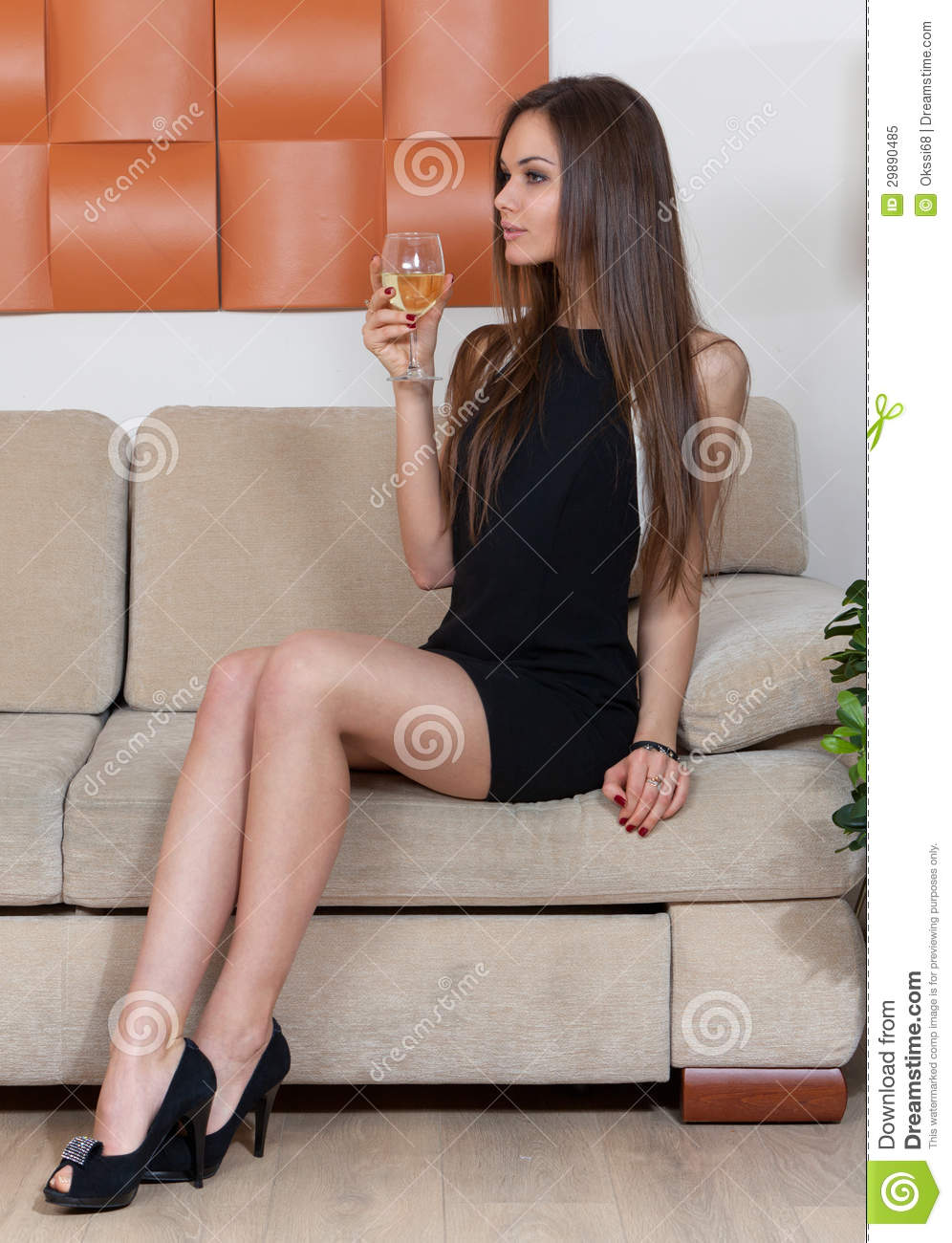 Elegant Woman With A Glass Of Wine Royalty Free Stock  : elegant woman glass wine sitting sofa 29890485 from www.dreamstime.com size 996 x 1300 jpeg 140kB