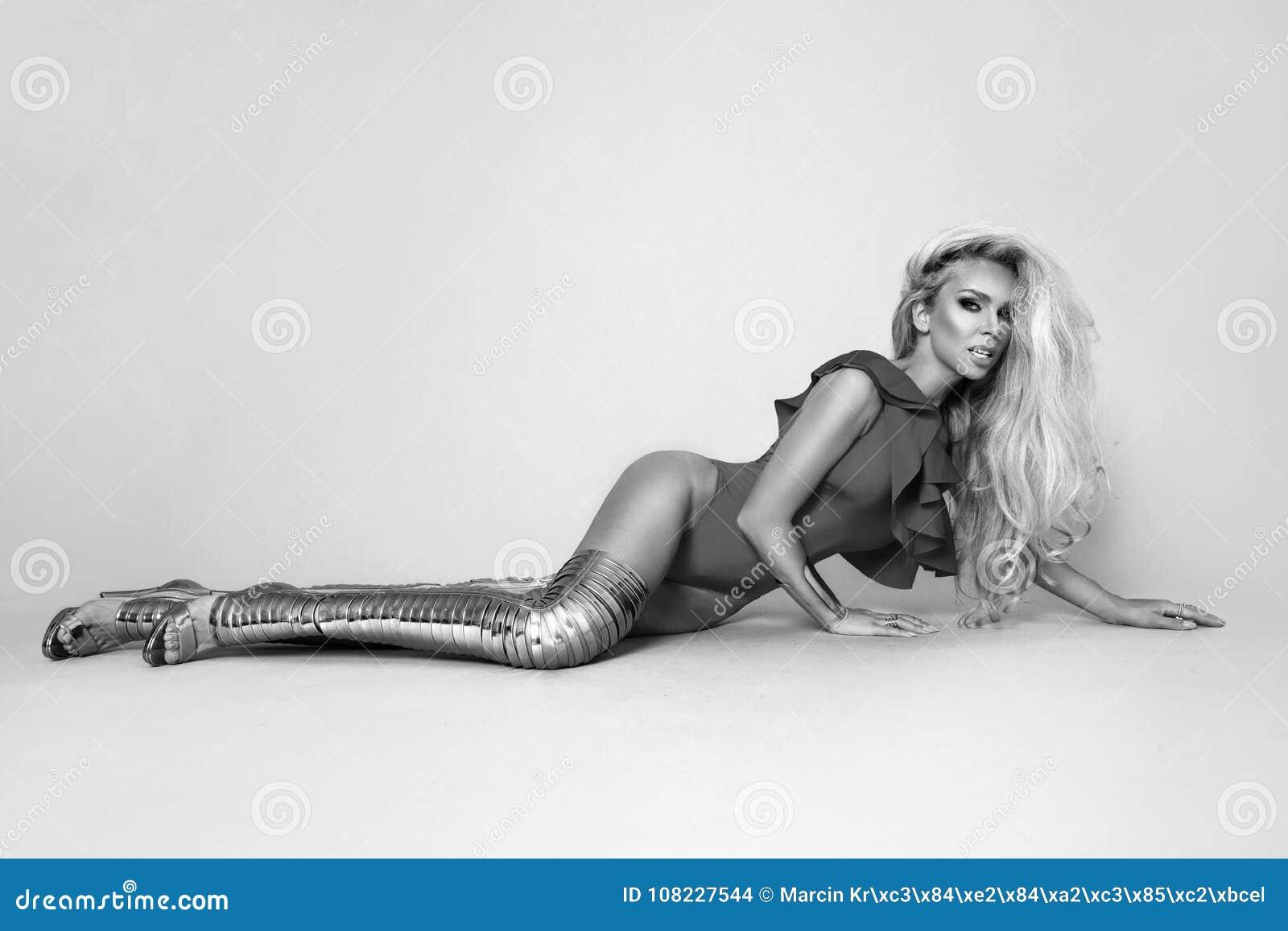 5e6f7c80b3c Elegant woman in bikini and amazing gold high heels shoes on a beige  background