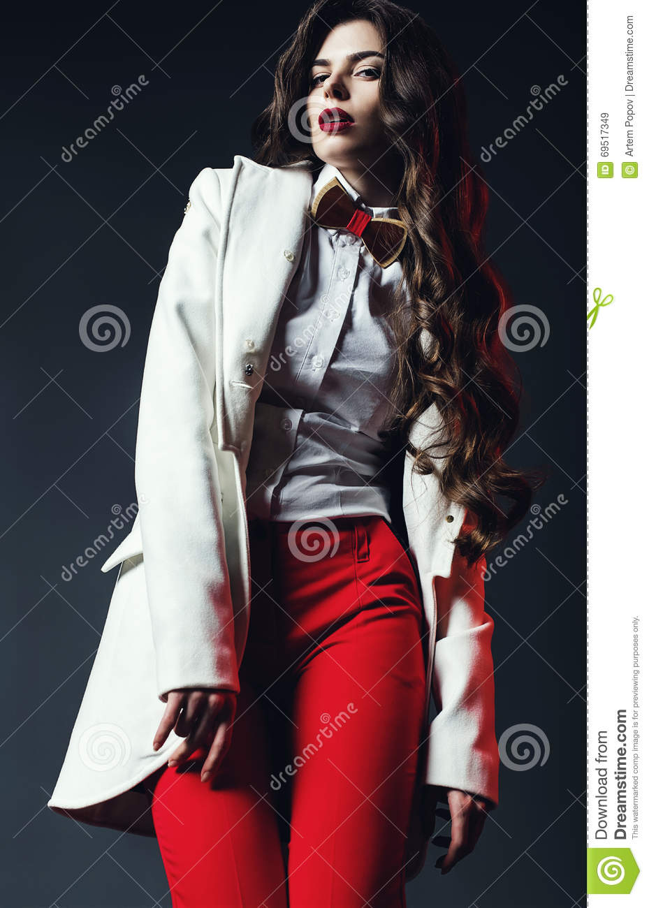 Elegant Woman In White Shirt With Bow Tie And In Red Pants ...