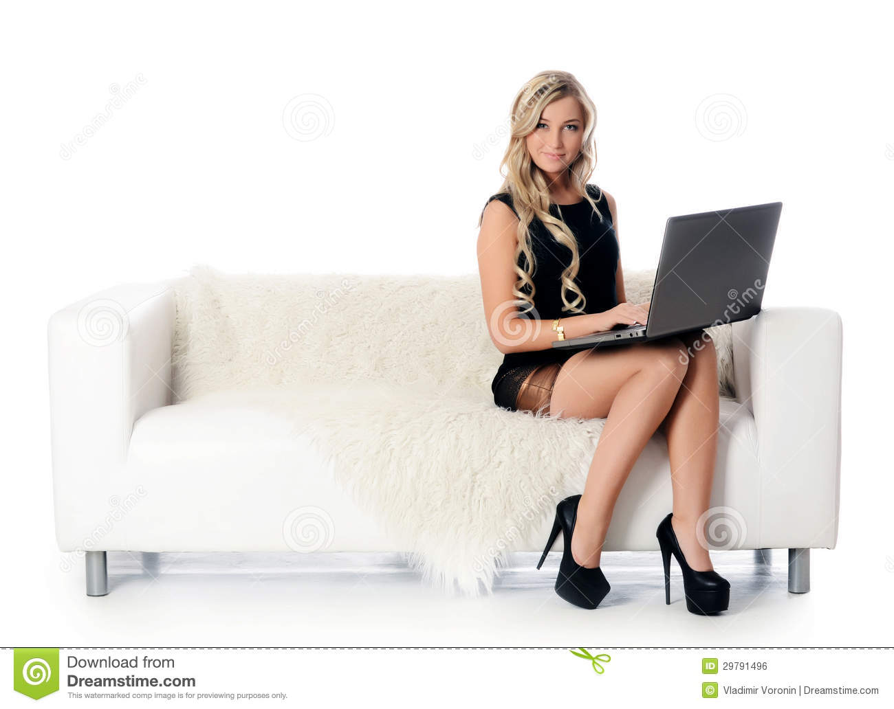 The Elegant Woman On A White Sofa With The Laptop