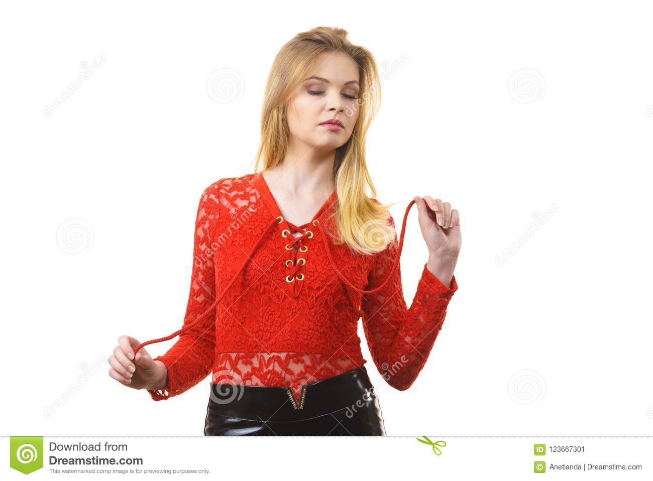6cc0e147602 Elegant young woman wearing red lace top. Female presentig stylish  fashionable outfit.