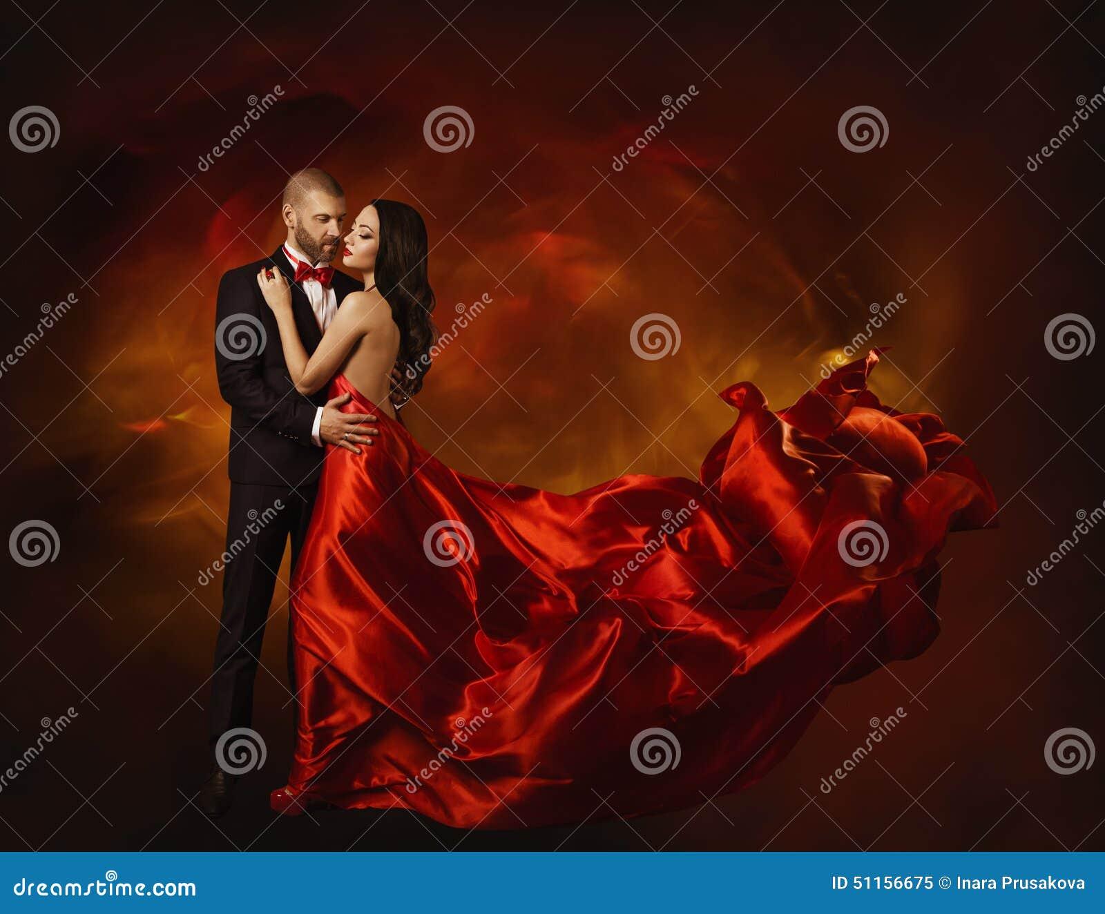 Elegantes Paar-Tanzen in der Liebe, Frau in der roten Kleidung und Liebhaber
