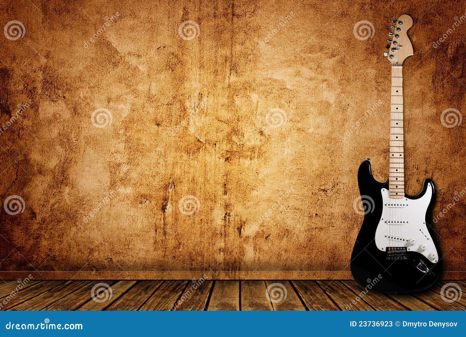 elektrische gitarre und die wand stockbild bild von konzert einlegearbeit 23736923. Black Bedroom Furniture Sets. Home Design Ideas