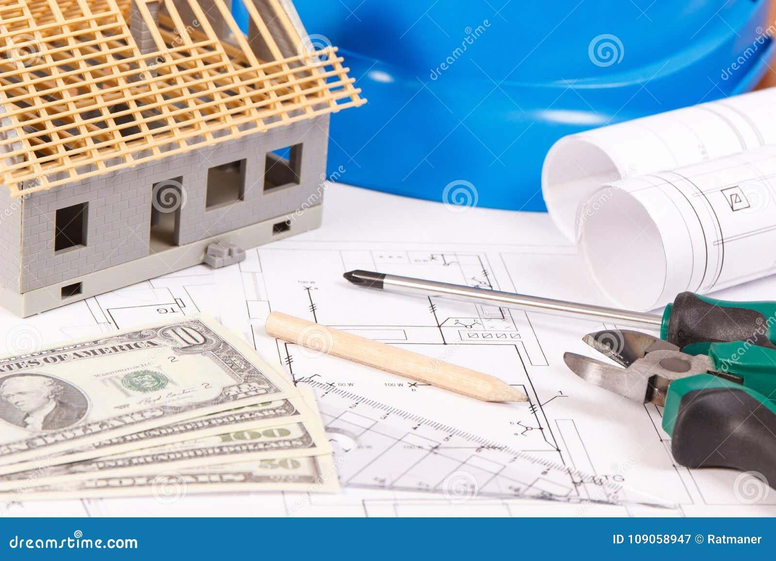 Elektrisk byggnadsritningar, arbetshjälpmedel och tillbehör, litet leksakhus och valutadollar som bygger hem kostat begrepp