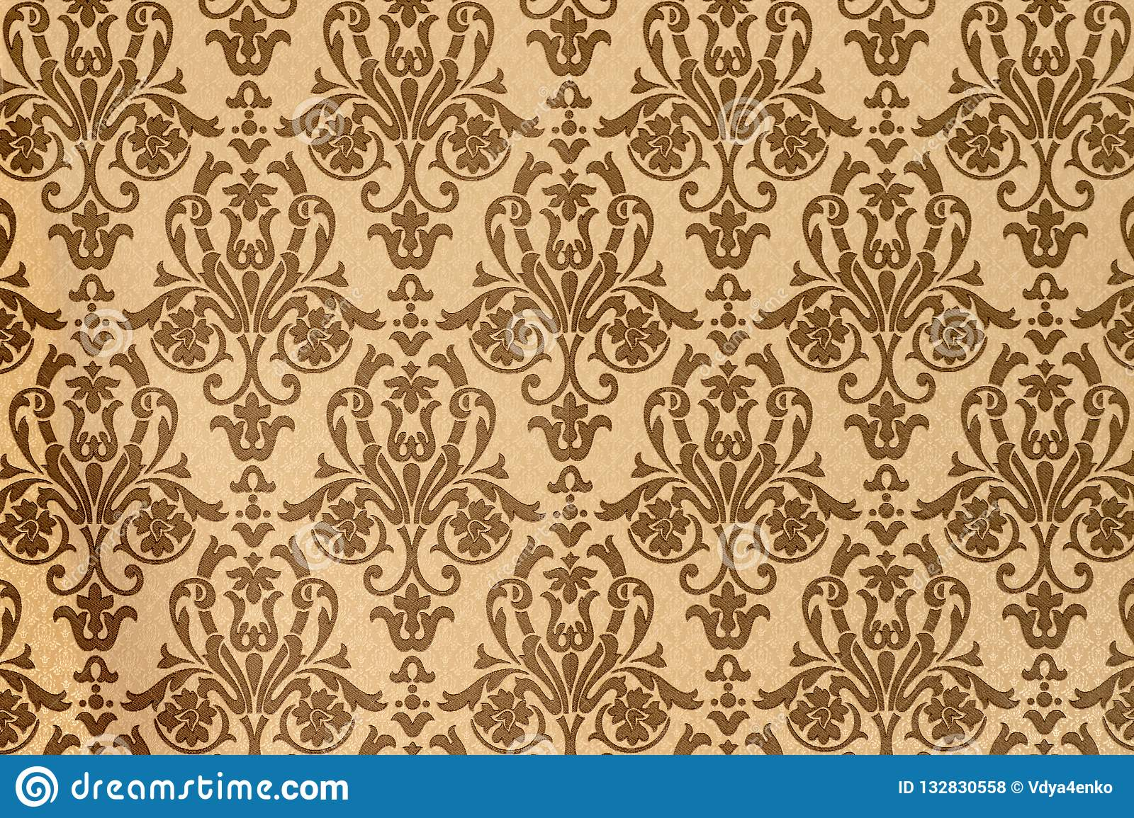 Element of interior decoration of the house. Brown-coffee pattern of Baroque style wallpapers