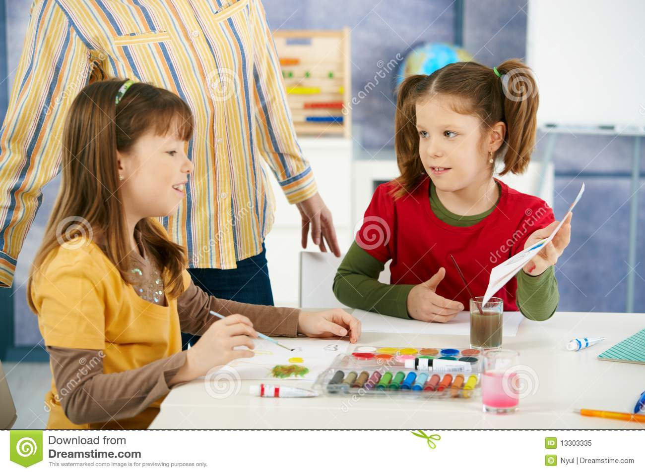 Classroom Design Elementary ~ Elementary age children painting in classroom royalty free