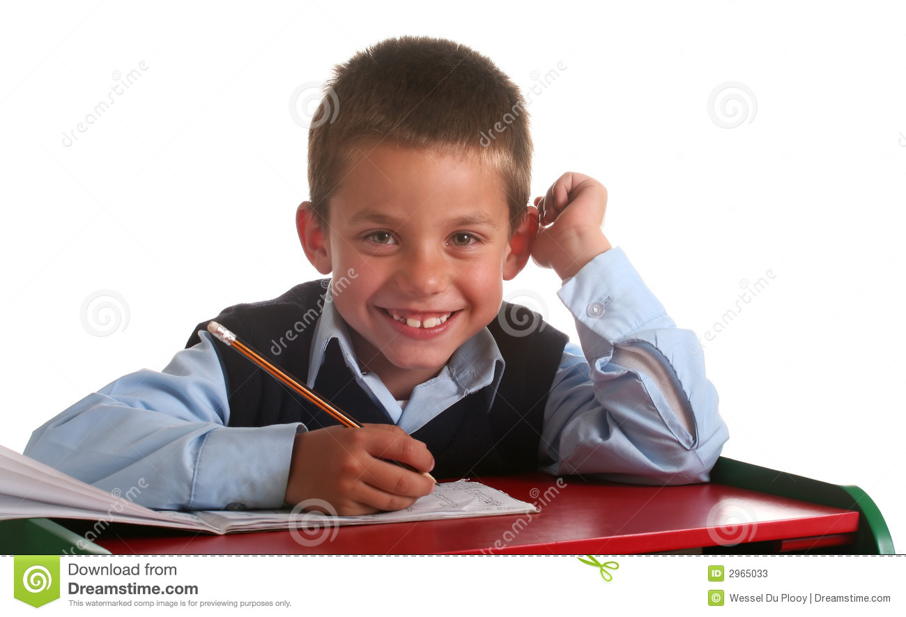 Young boy in elementary/primary school uniform working.