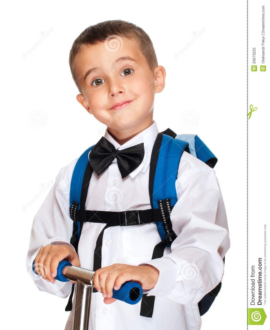 Elementary student boy with backpack and scooter isolated on white.