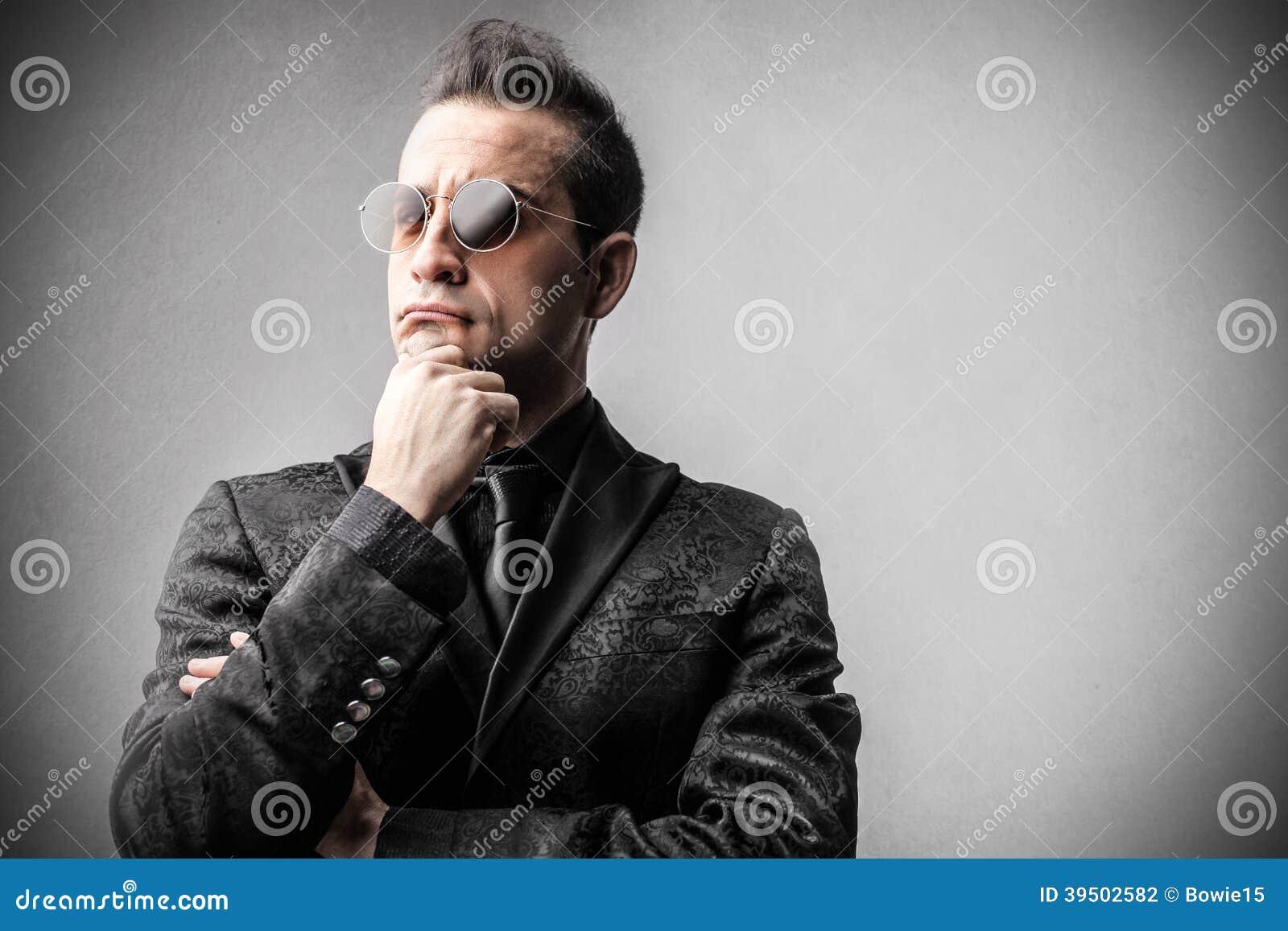 Elengat rich businessman thinking
