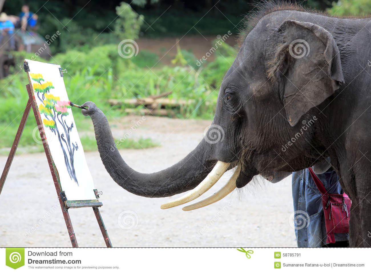 An elephant is drawing a picture