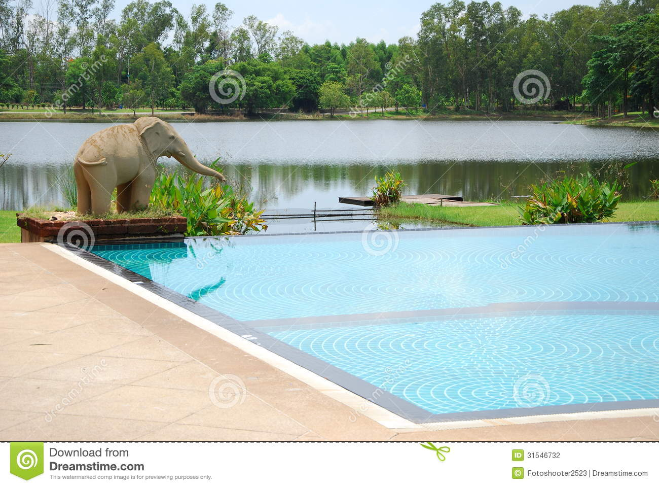 Elephant statuary near swimming pool stock photography for Garden elephant pool