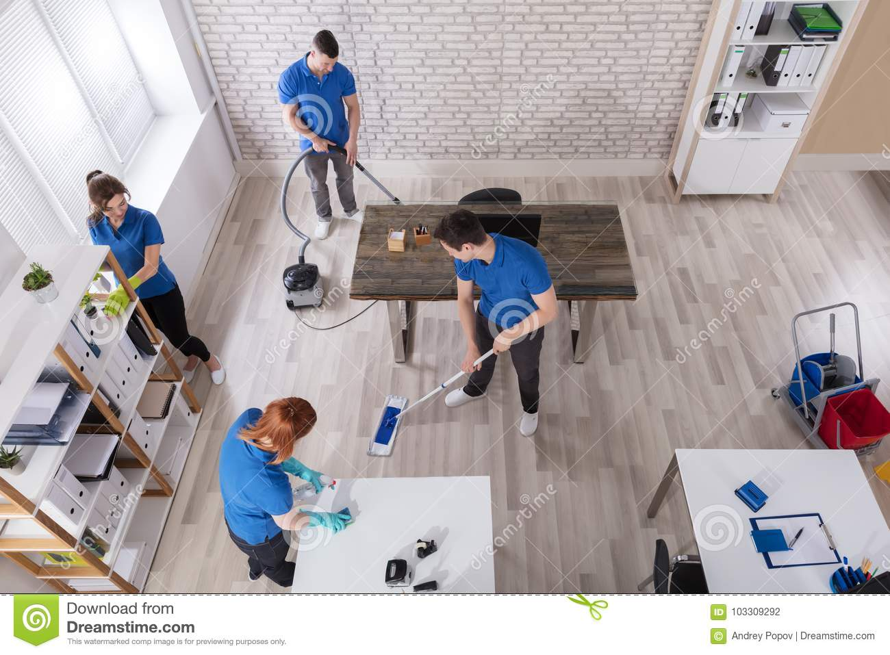 Elevated View Of Janitors Cleaning The Office