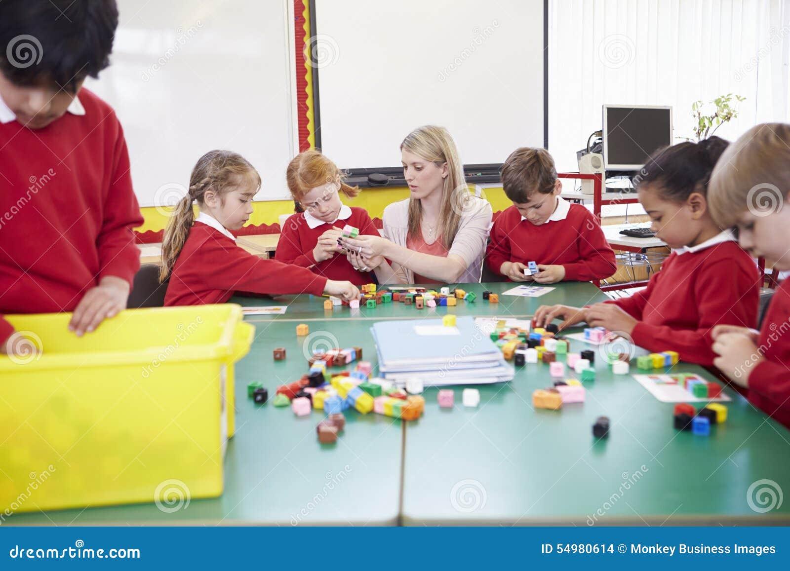 Elever och lärareWorking With Coloured kvarter