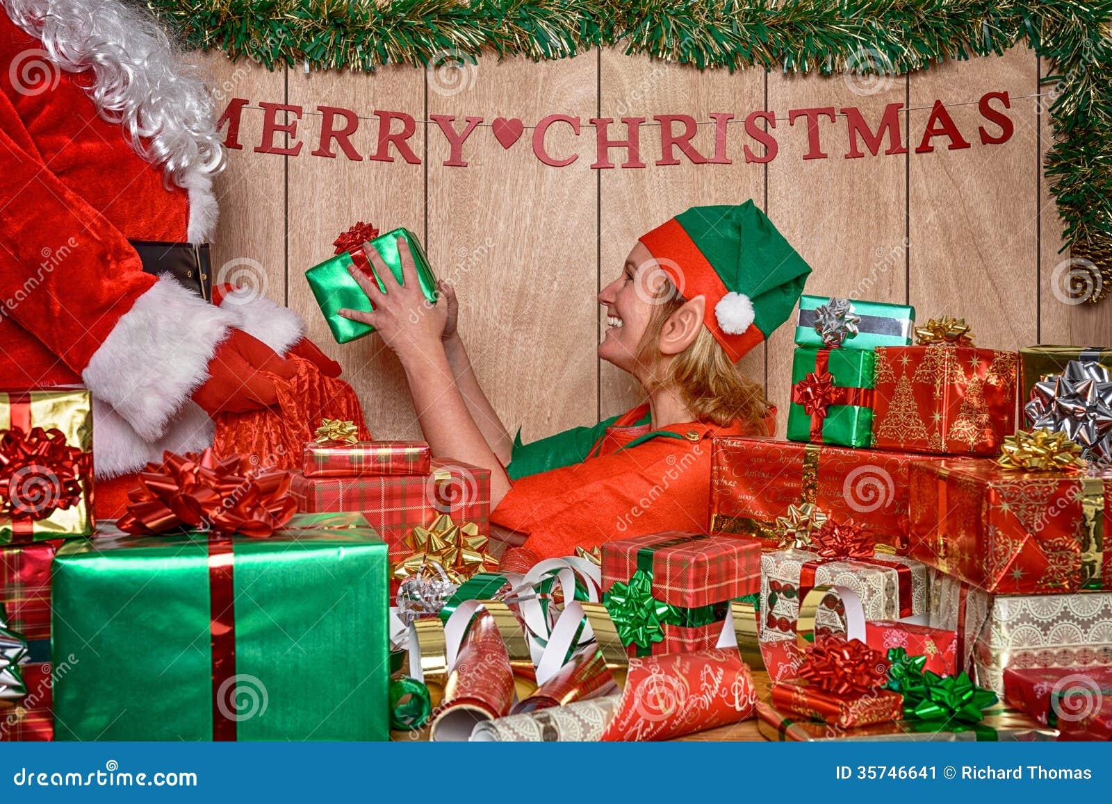 Elf Puttings Presents In Santa's Sack Stock Image - Image: 35746641