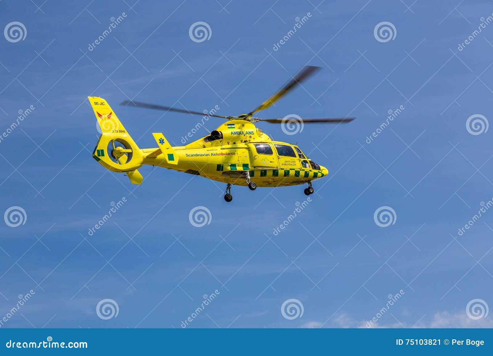 Elicottero E Ambulanza : Elicottero dell ambulanza in metà di aria fotografia