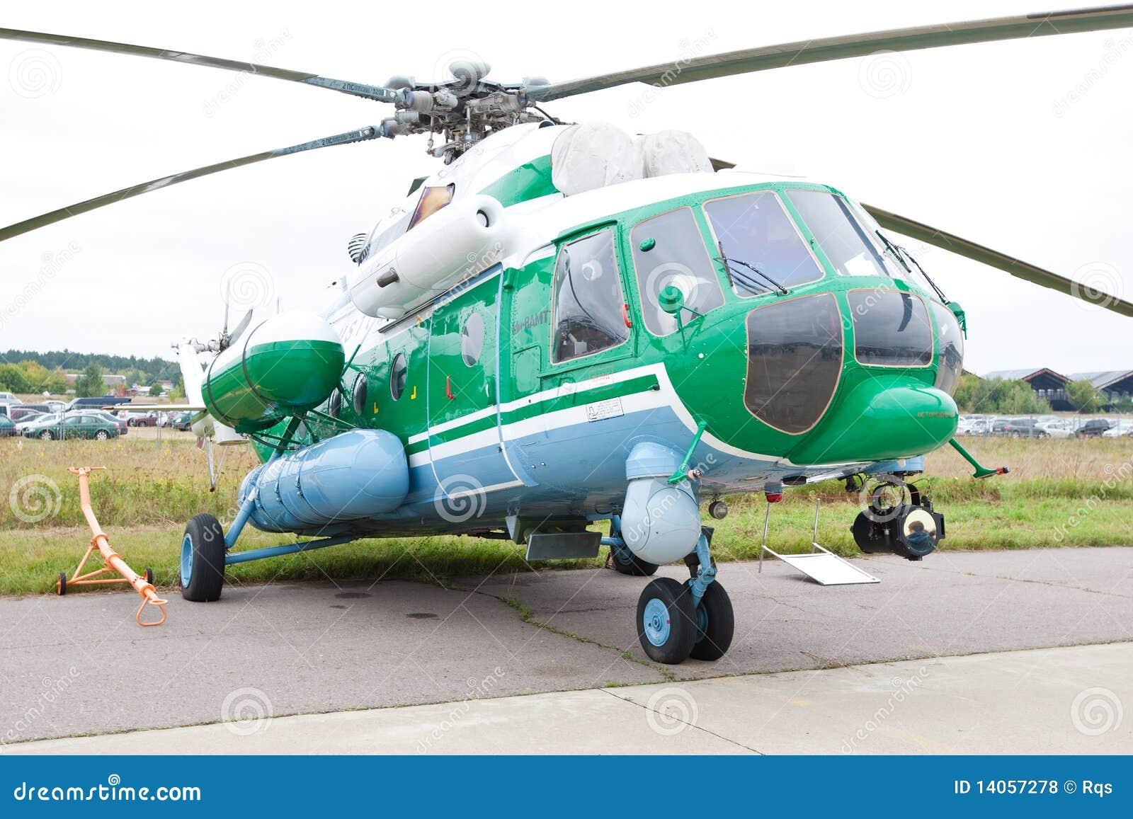 Elicottero Verde E Giallo : Elicottero militare verde e grigio fotografia stock
