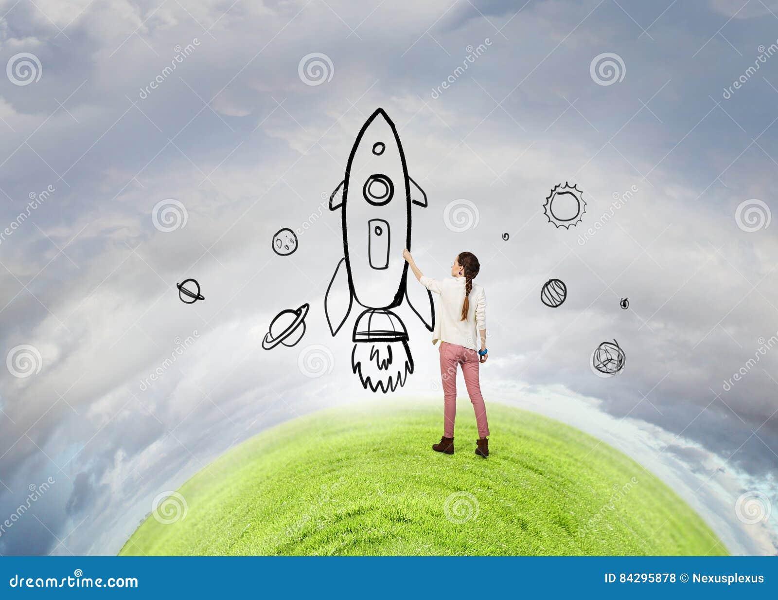 6720f9ac6b5e Cohete del dibujo de la mujer joven en la pared como concepto de la  astronomía. Imágenes stock más similares