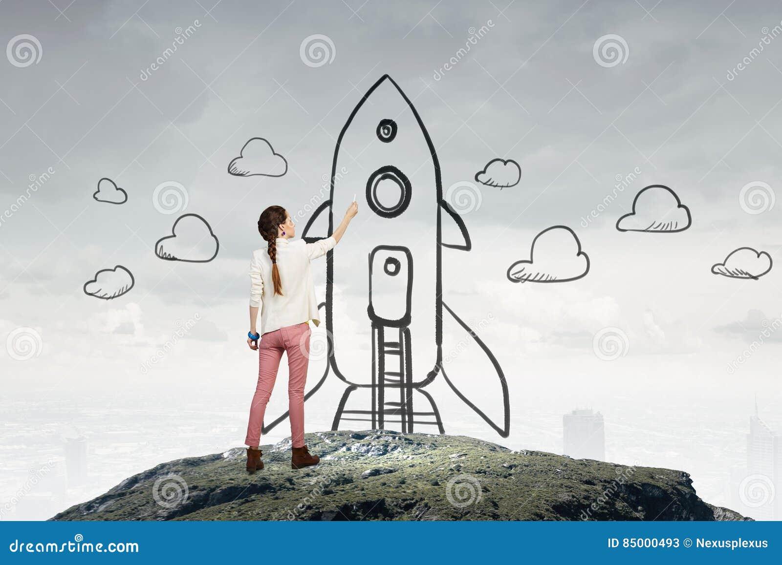 7bcb7e64427f Cohete del dibujo de la mujer joven en la pared como concepto de la  astronomía