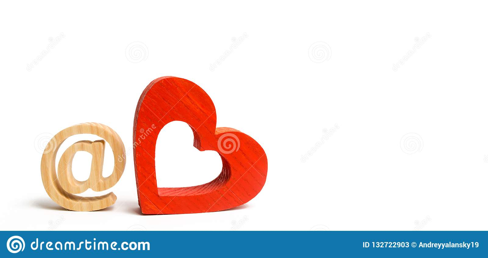 Email icon and red wooden heart. Internet dating concept. Love online. Search for the second half. Familiarity in social networks