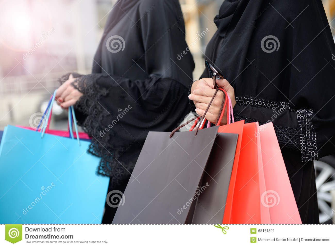 Emarati Arab Women Coming Out Of Shopping Stock Image - Image of