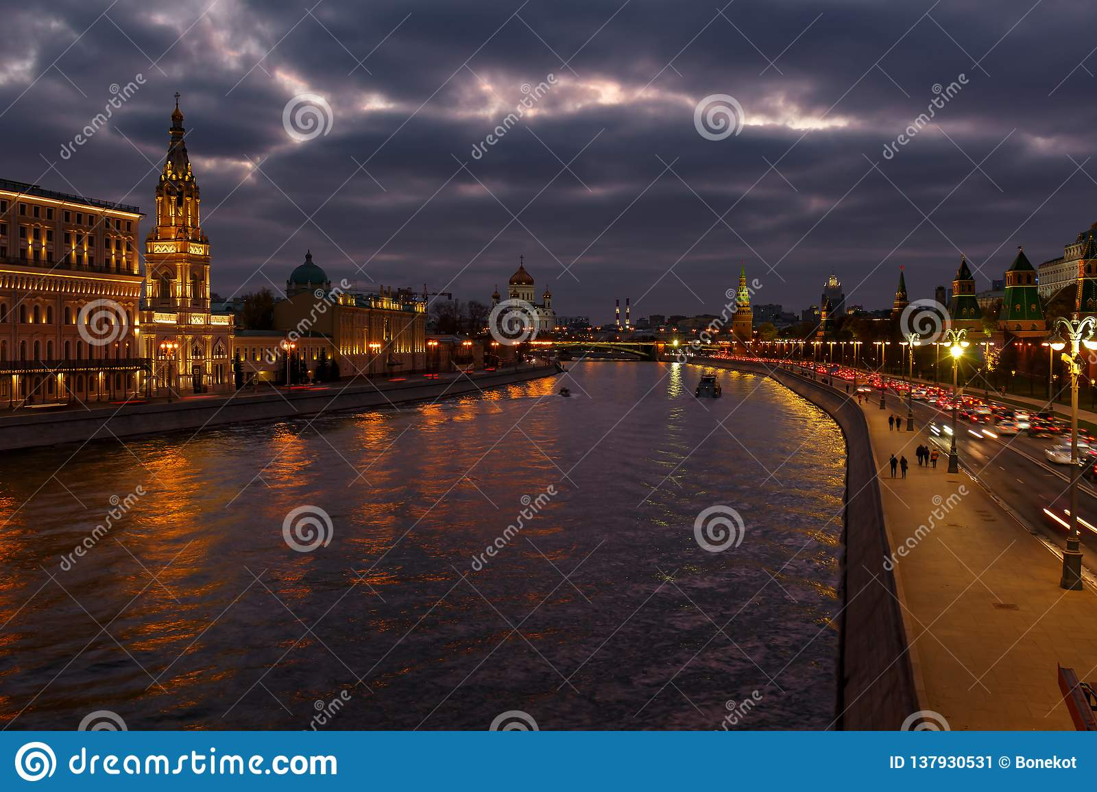 Embankments of Moskva river against Moscow Kremlin on a background of cloudy sky at evening. City landscape