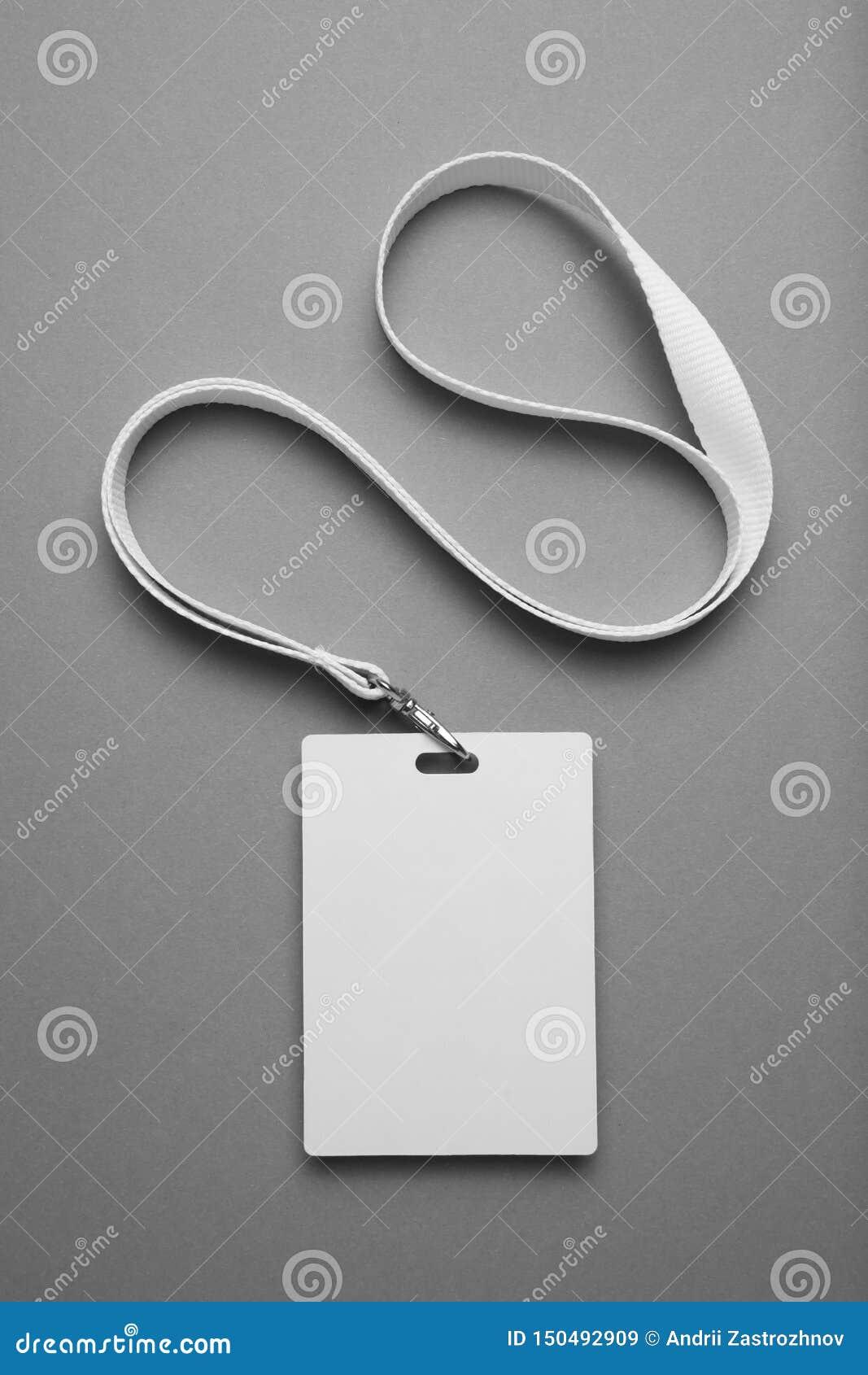 Emblemet personalID-modell, namnger etikettstaljerepidentitetskorten på grå bakgrund