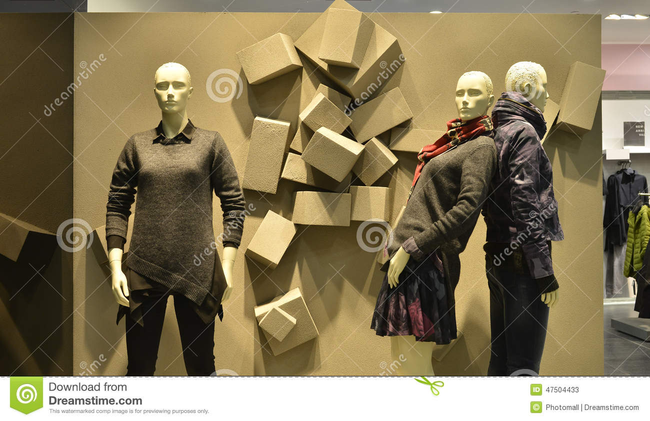 Embossed Background And Autumn Winter Fashion Mannequins