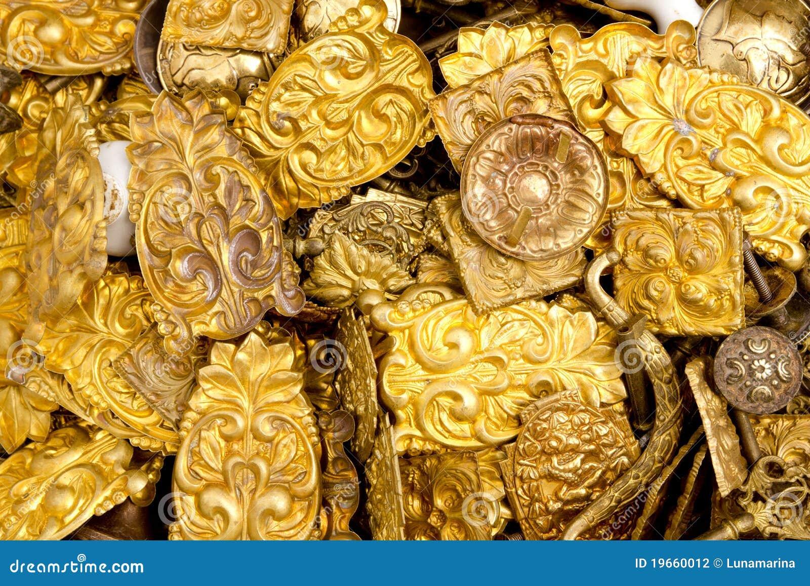 Embossed brass golden metal decorative pieces stock photo