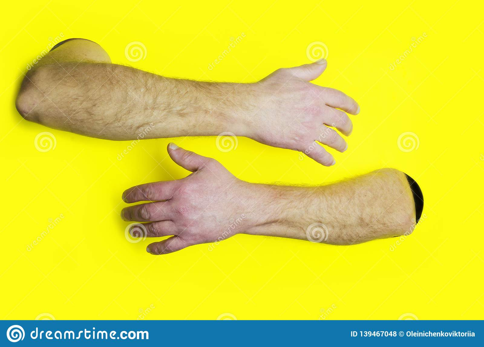 Embrace or hugging design template.Male hands hugging somebody against yellow background.Concept of support