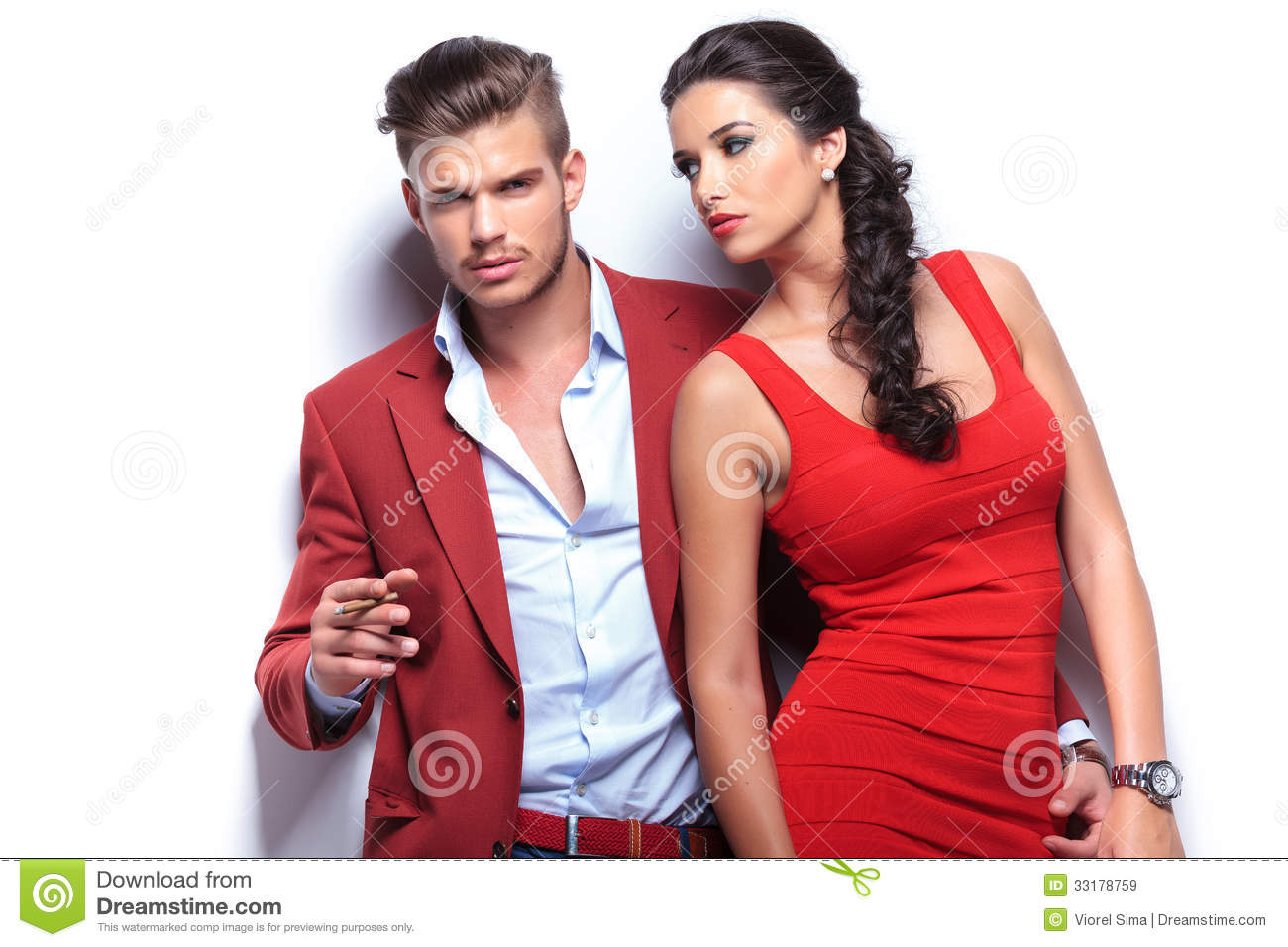 Embraced Fashion Couple Leaning Against White Wall Royalty