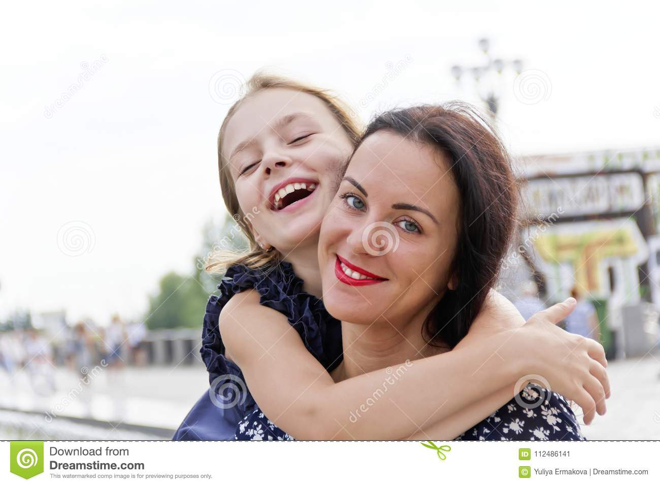 Embracing and laugh mother and daughter