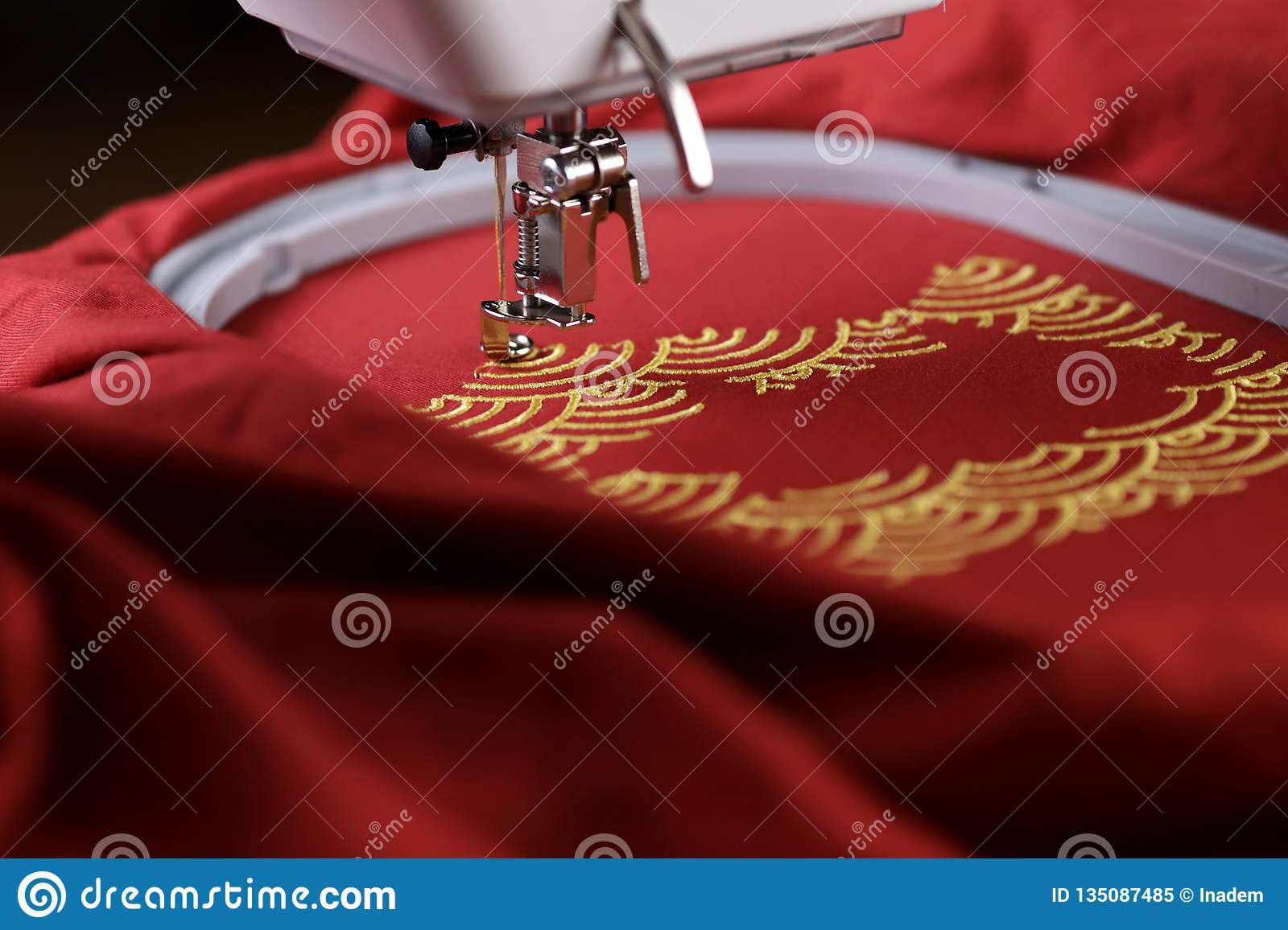 Embroidery Of Shell Pattern Framing Pig Outline With Gold On