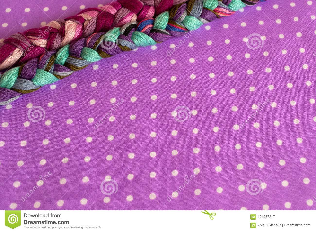Embroidery Threads Of Different Colors On A Purple Background Stock